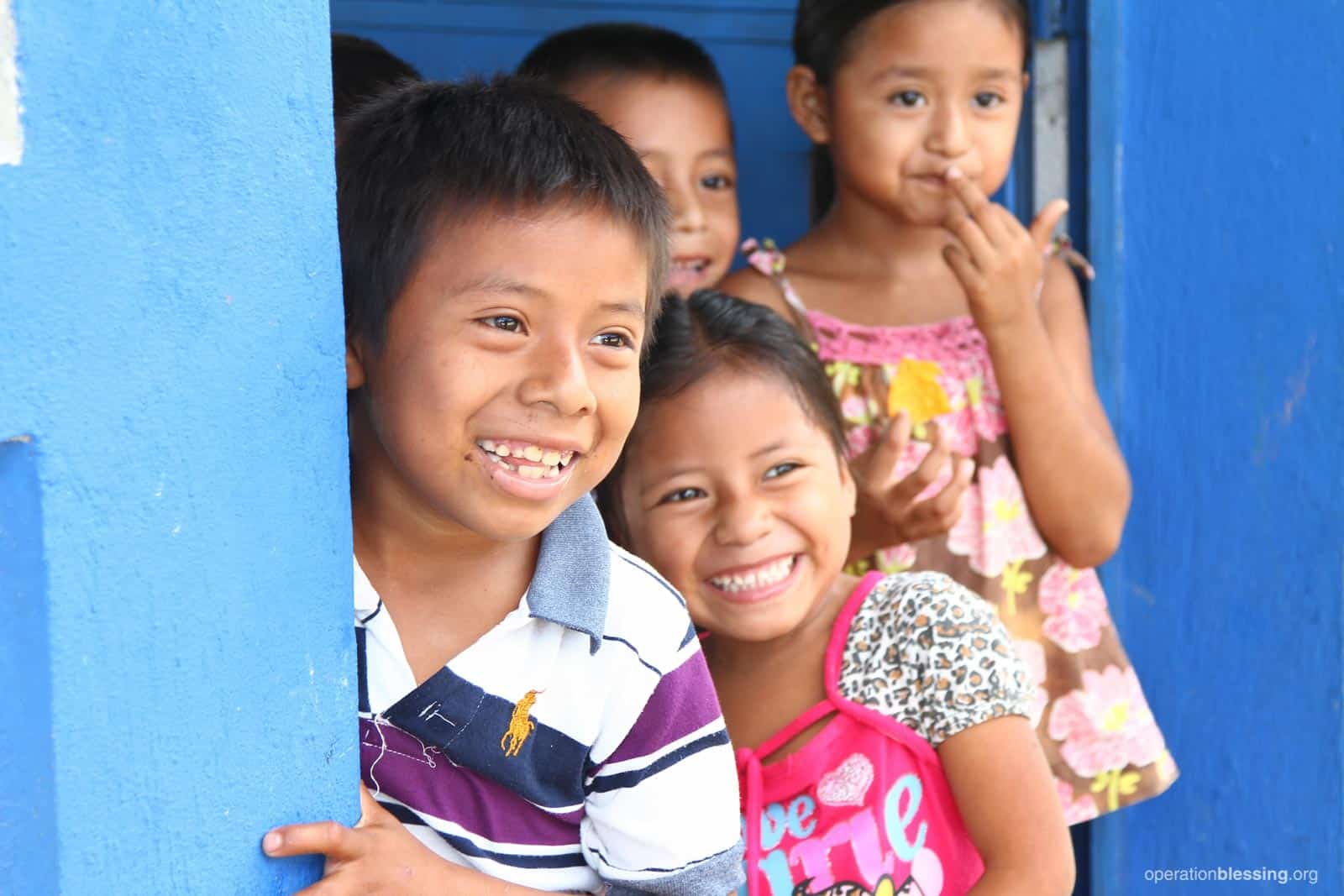 Vilma (middle) and her classmates are thankful for the new facilities at her school with no scorpions!