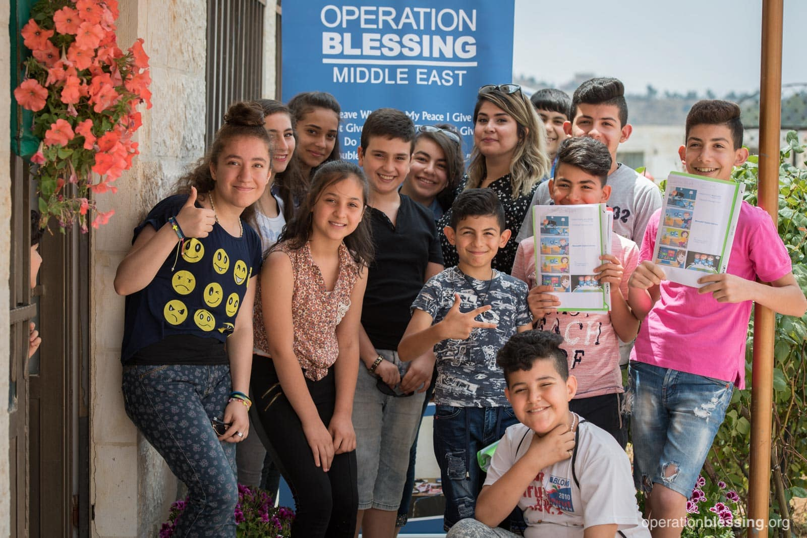 Nataly poses with her friends at the Operation Blessing training center.