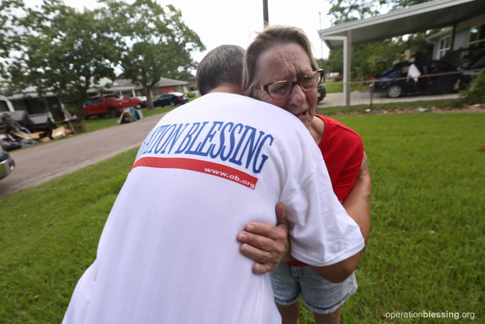 Craig gives a hug to Sandy, who has lost so much after Hurricane Harvey.