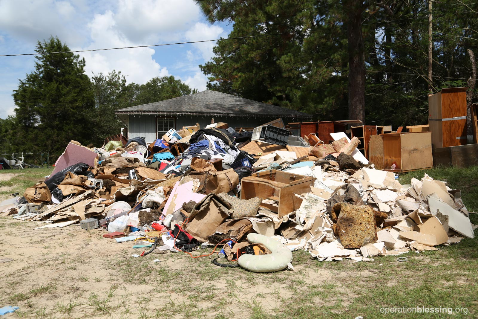 The debris pile outside of Laura's house filled with destroyed belongings and family memories.