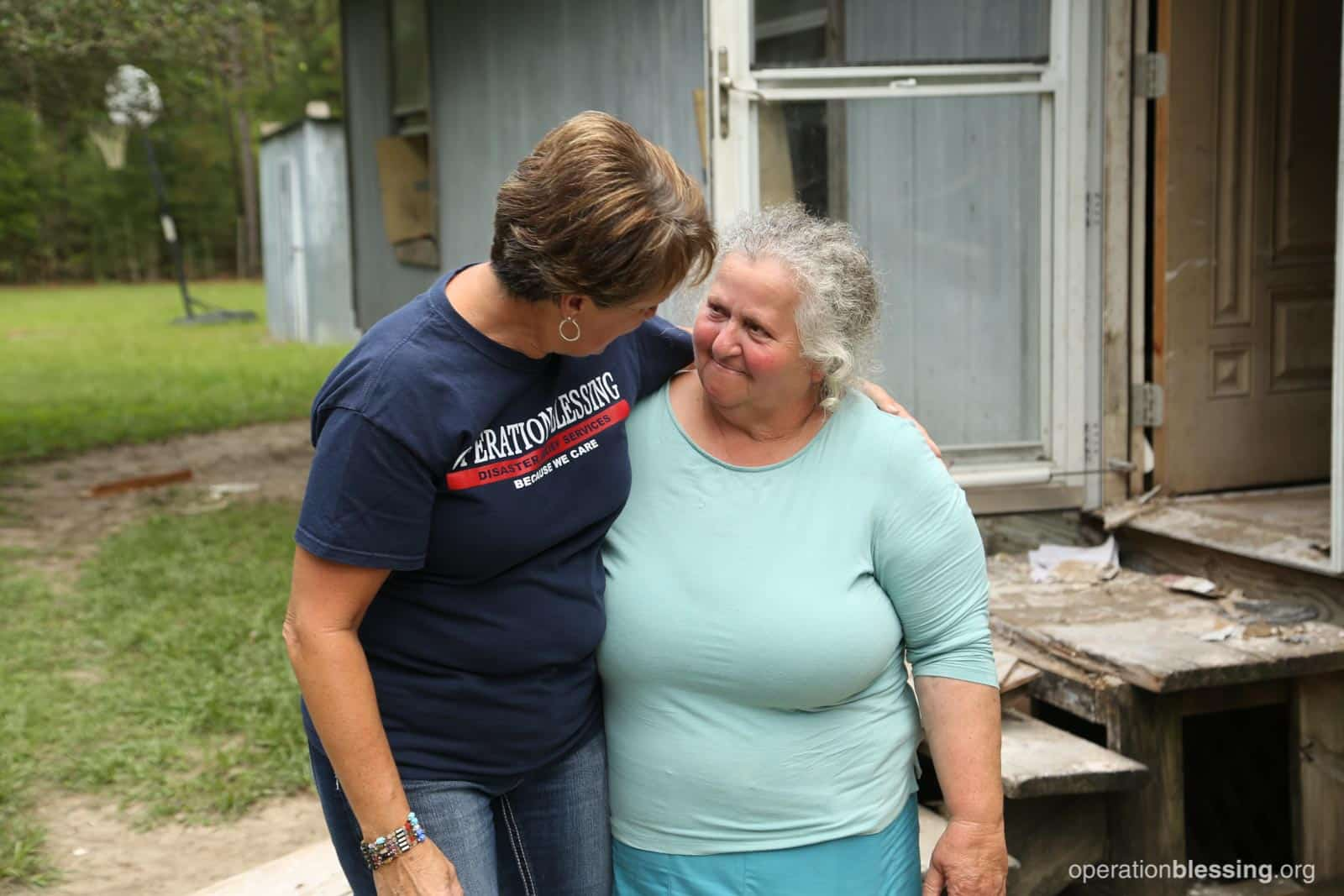 Operation Blessing field worker embraces an amazing woman named Laura after Hurricane Harvey flooded her home in Texas.