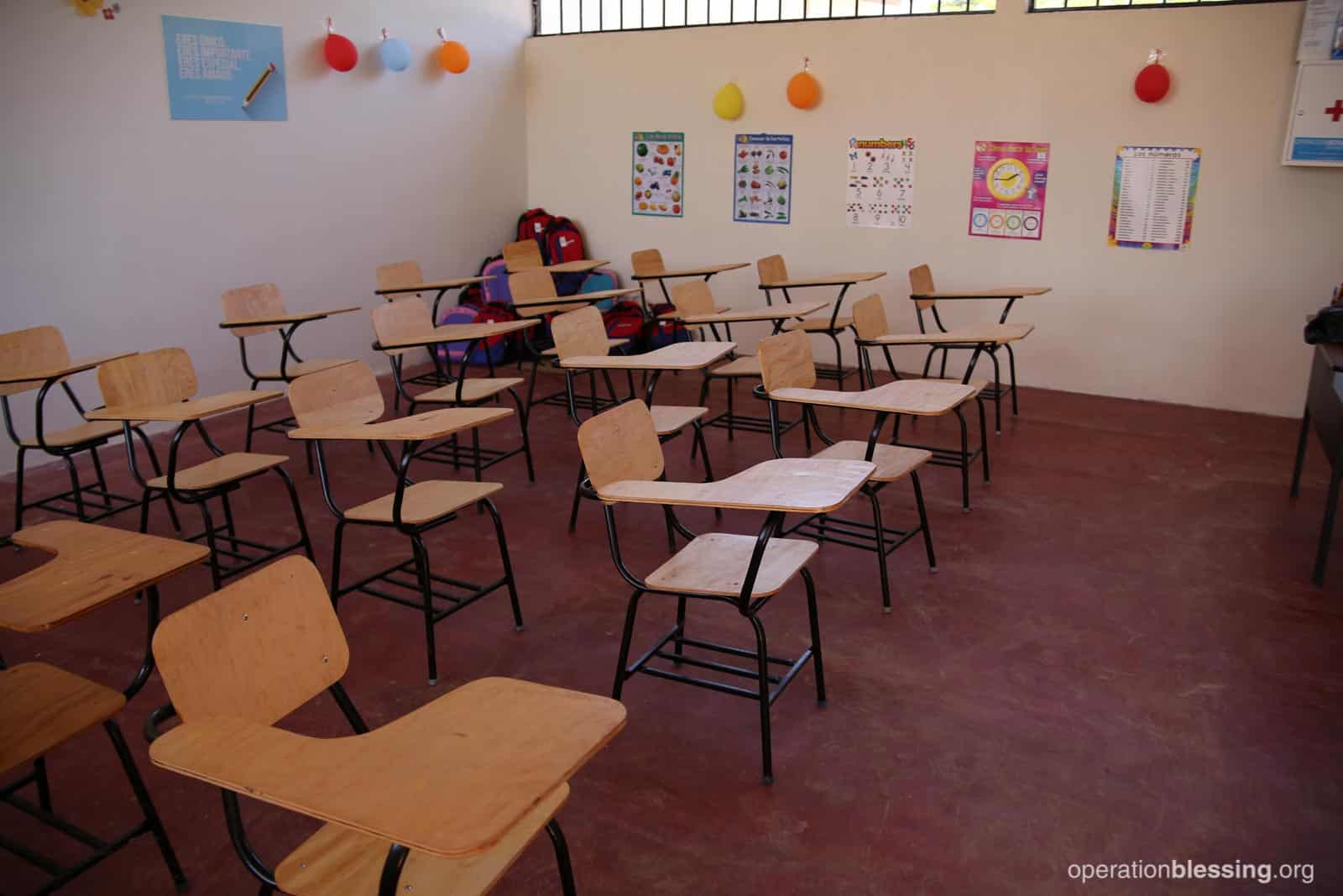 New desks adorn one of the classrooms of Marlon and Cristian's school.