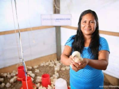 Elizabeth and her family are participating in Operation Blessing's Family Poultry Project, wherein they learn how to care for a chicken coop.