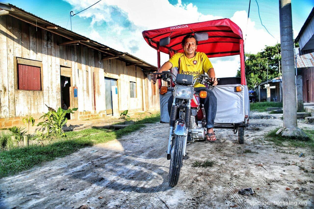Elizabeth's husband Andres drives a mototaxi