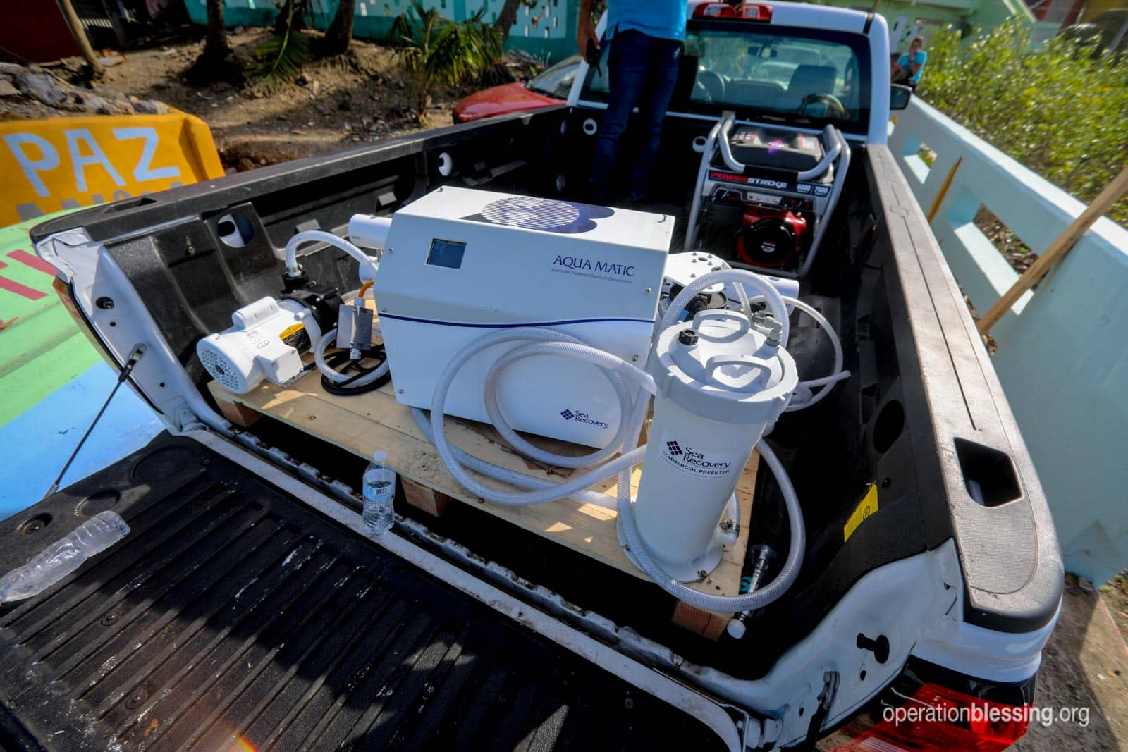 The Aqua Matic Reverse Osmosis Desalinator in the back of a truck.