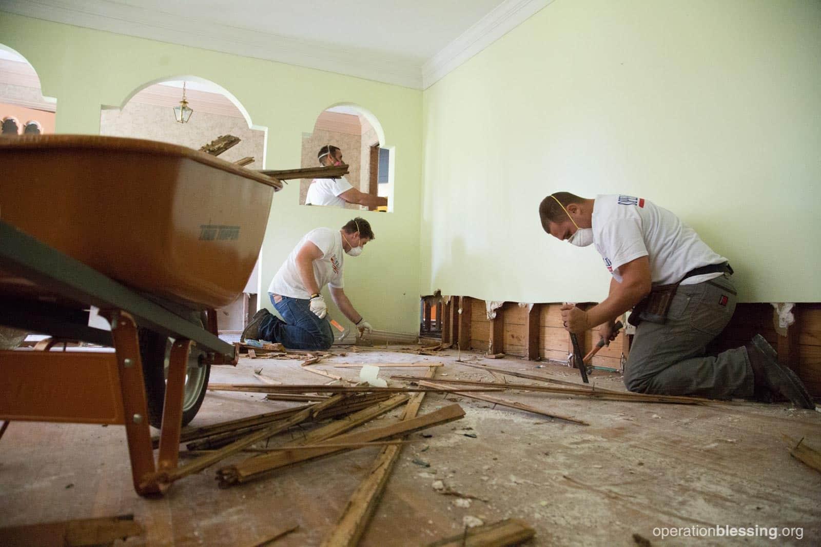 The volunteer team from Pennsylvania works on Karen's house.