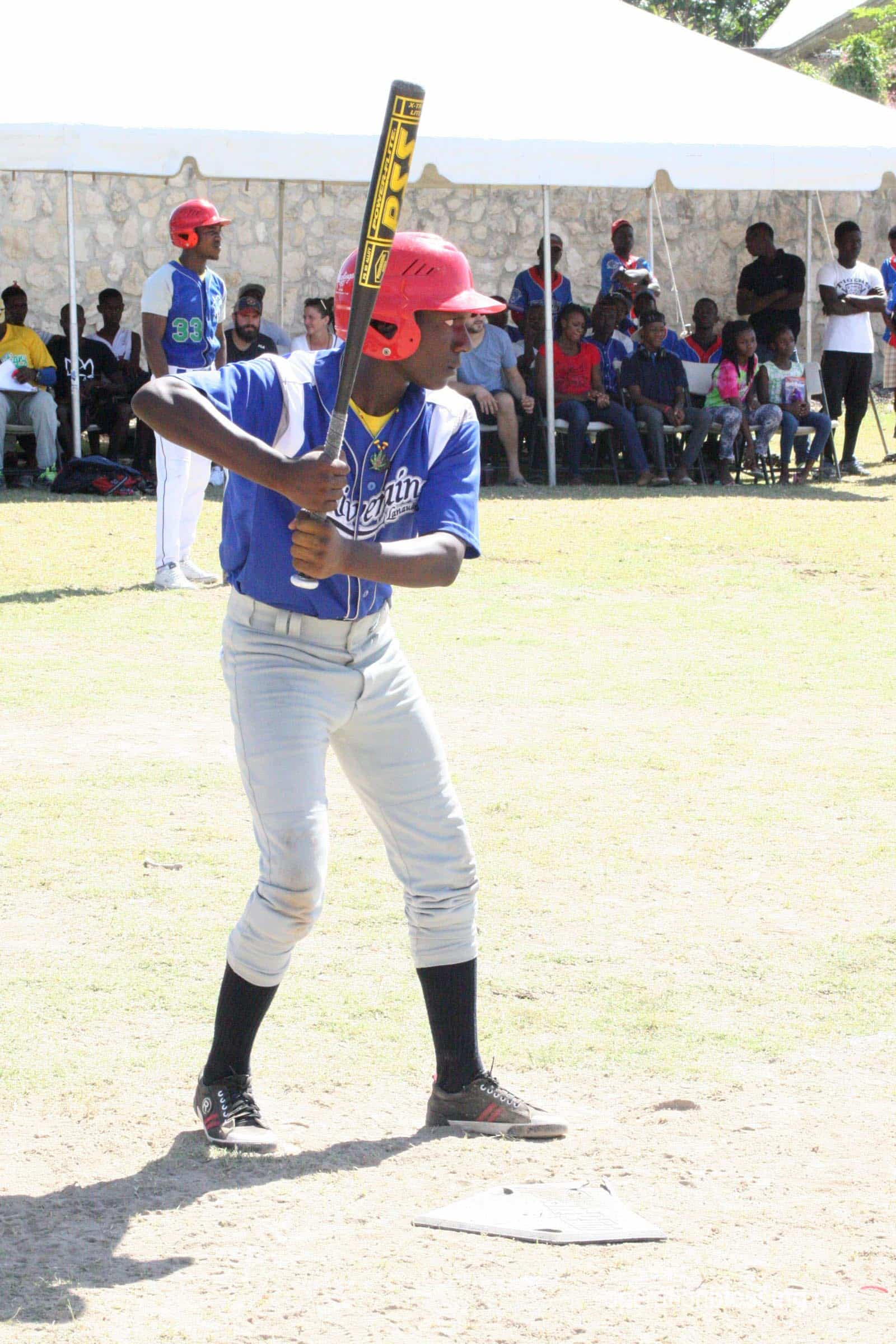 A Tabarre Tiger stands at the plate.