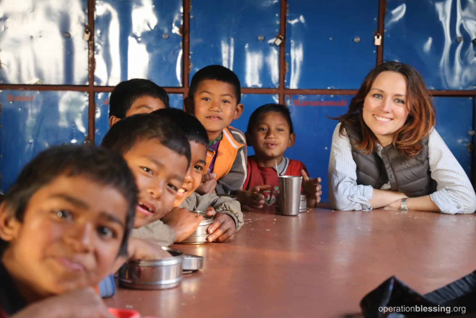Children rescued from child labor in Nepal enjoy a healthy meal.