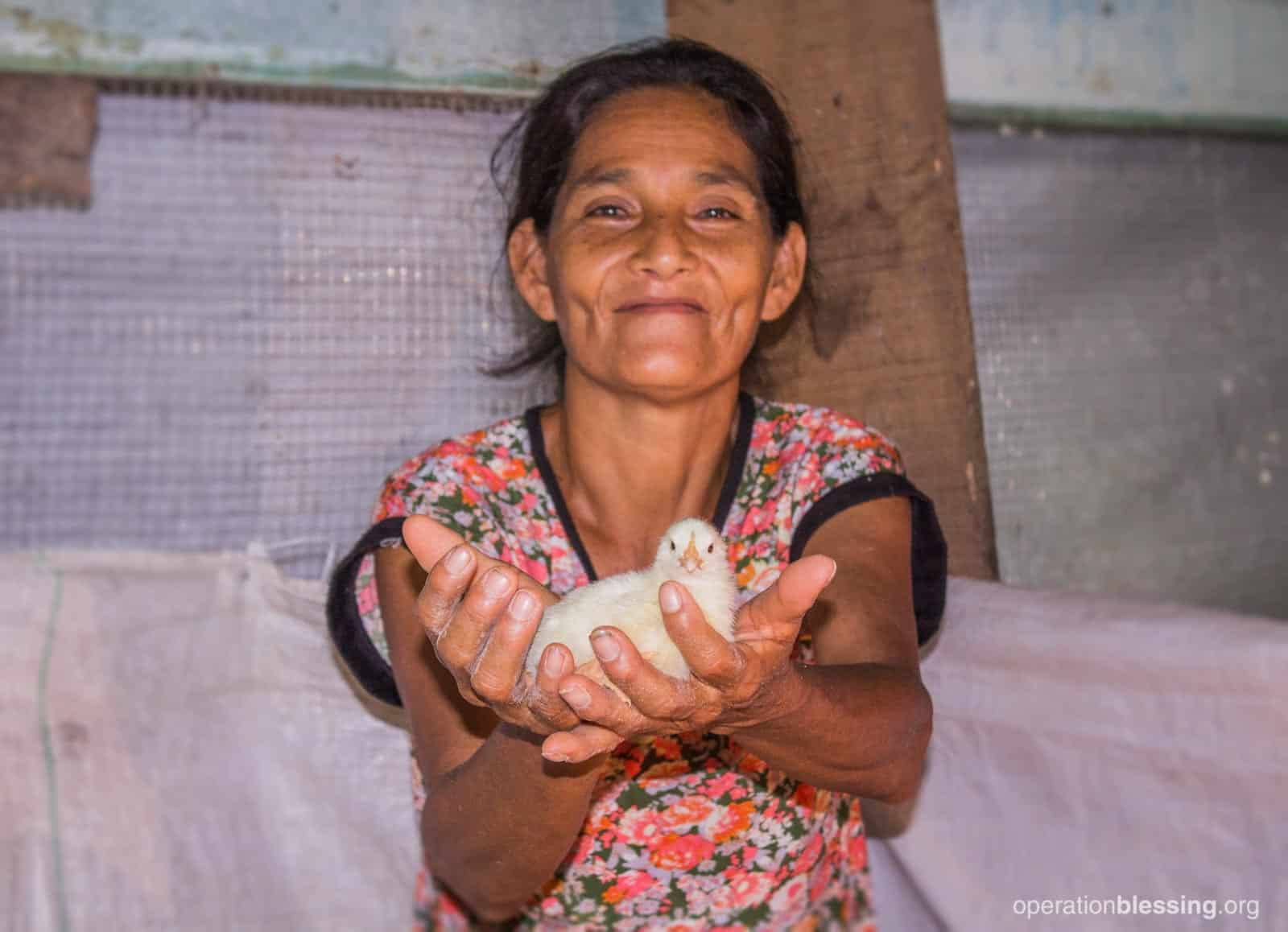 Single mother Ermelinda is part of a poultry project in Latin America that helps keep her family fed.