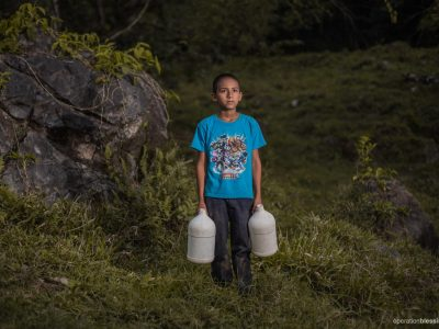 Each morning Oscar would travel from his rural community of San Rafael to fetch water.