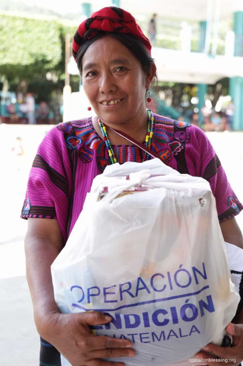 This woman holds a bag of supplies given to her by Operation Blessing after the earthquake in Guatemala.