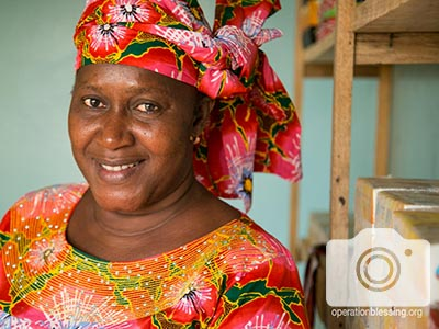 Aminata was left widowed and penniless when her husband passed, but now smiles in her new shop