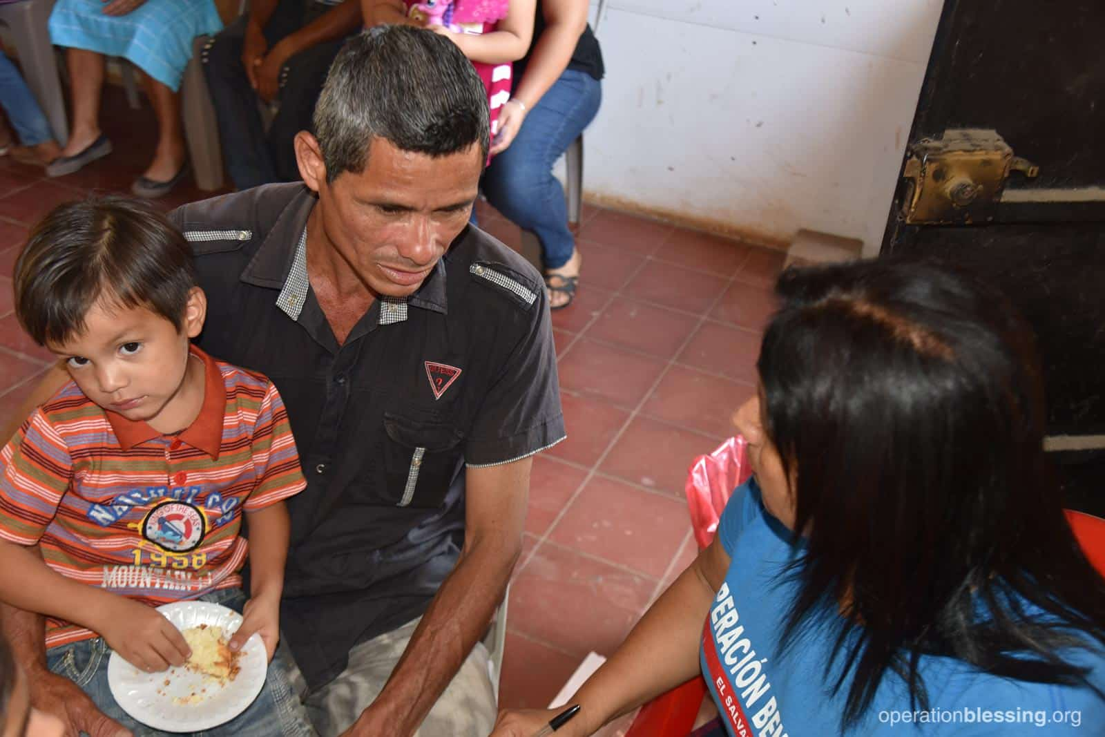 Santos and his son at an Operation Blessing medical brigade.