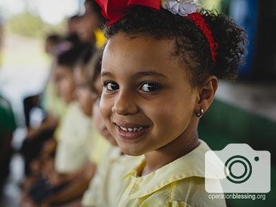 A child smiles at the Christmas celebration.