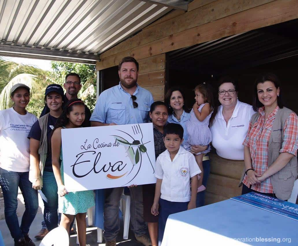 Operation Blessing staff with Elva for the grand opening of Elva's kitchen.