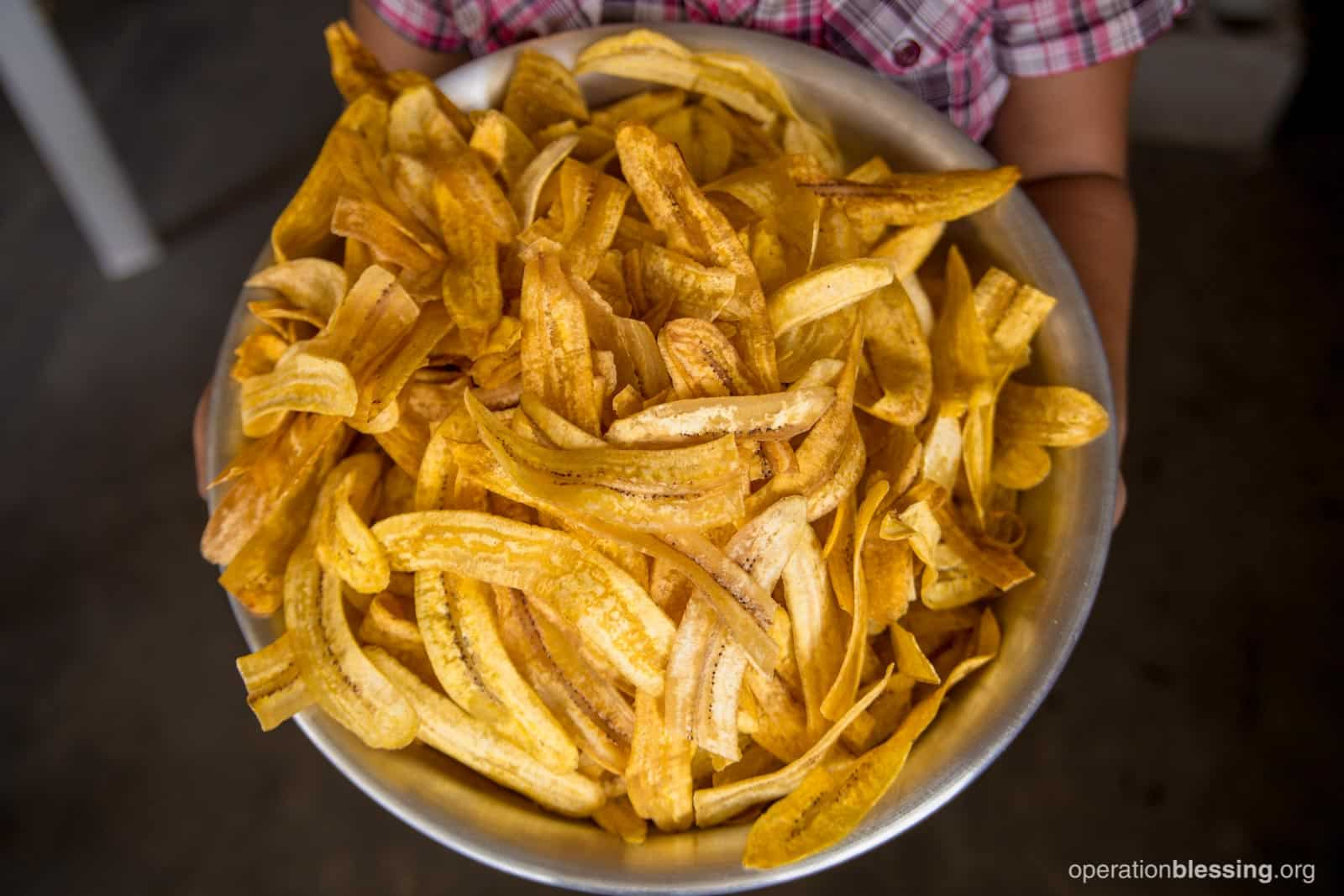 A big bowl of plantain chips made by Elva.