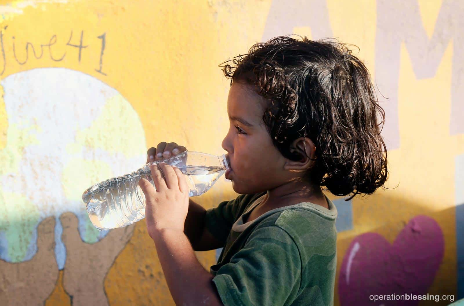 A young Puerto Rican boy drinks safe water.