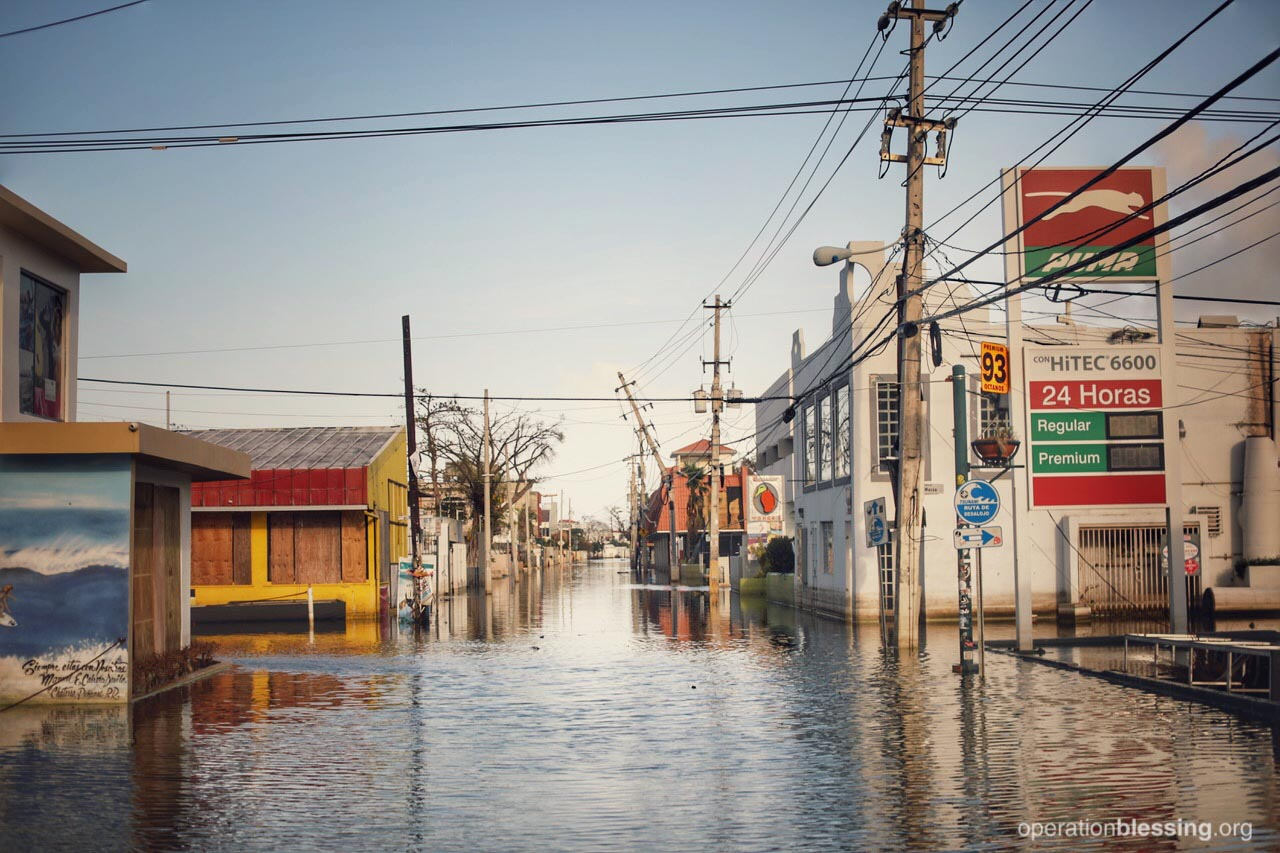 A flooded street shows Puerto Rico as in island in ruins following Hurricane Maria.