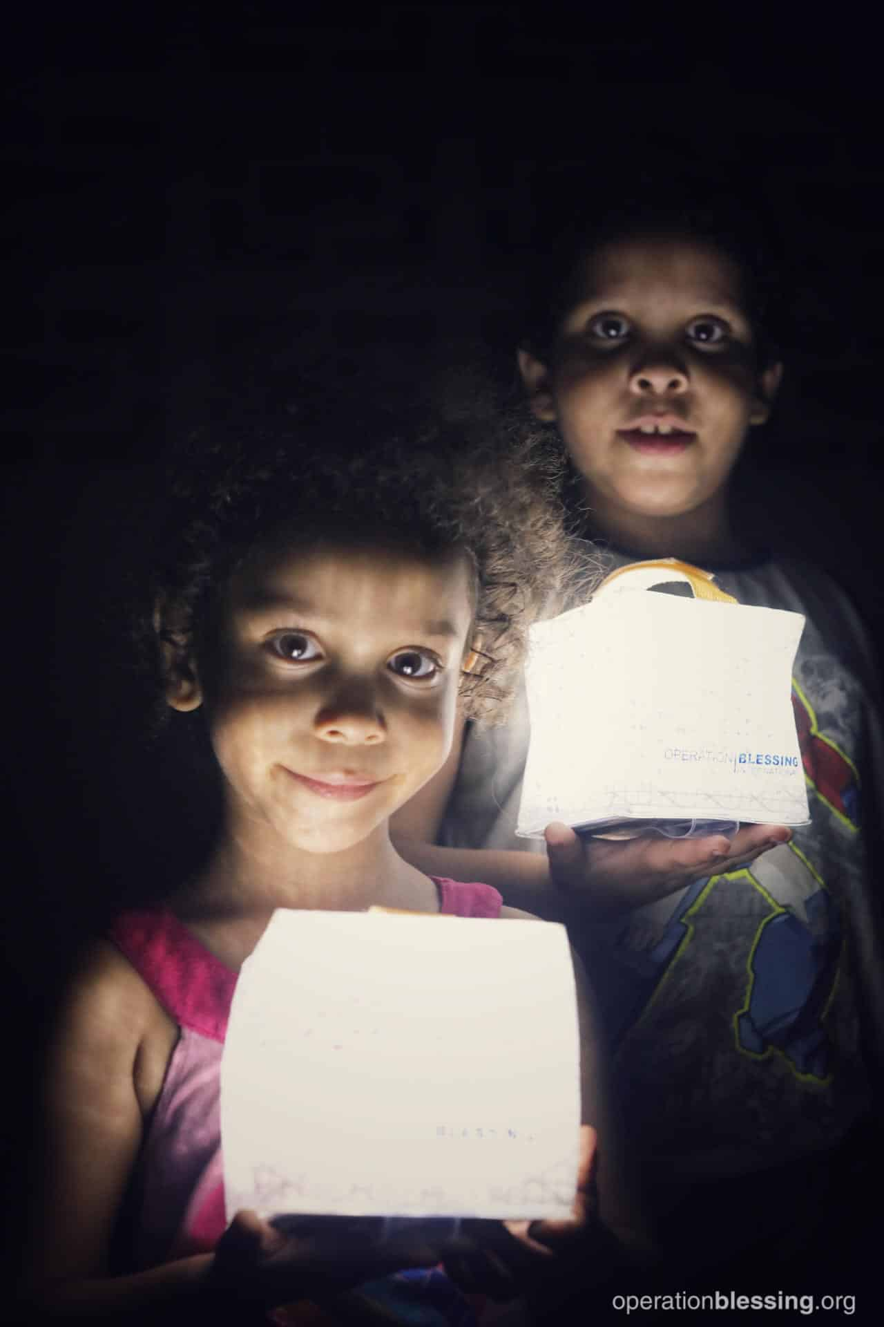 Solar lights from OBI provide light for children in Puerto Rico.