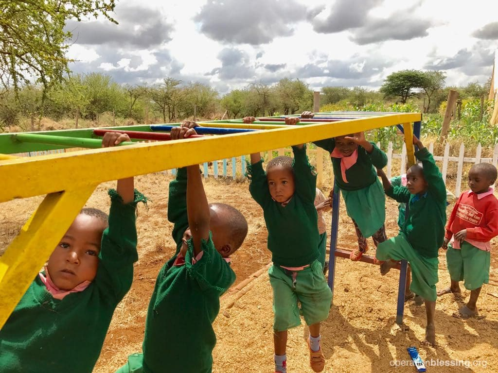 Children playing on the playground at an Operation Blessing sponsored school.