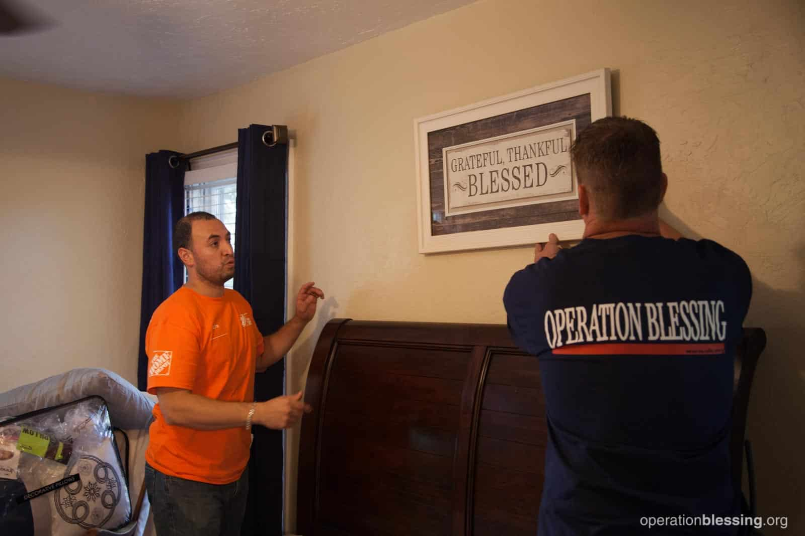 Workers from Operation Blessing and The Home Depot redecorate Priscilla's home.
