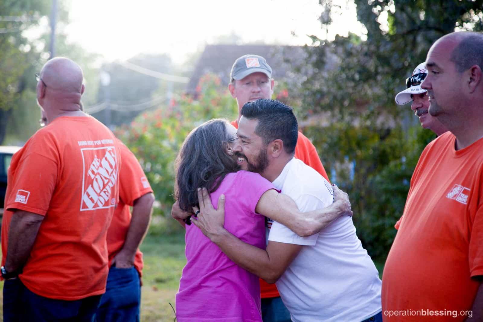 Priscilla hugs one of the volunteers.