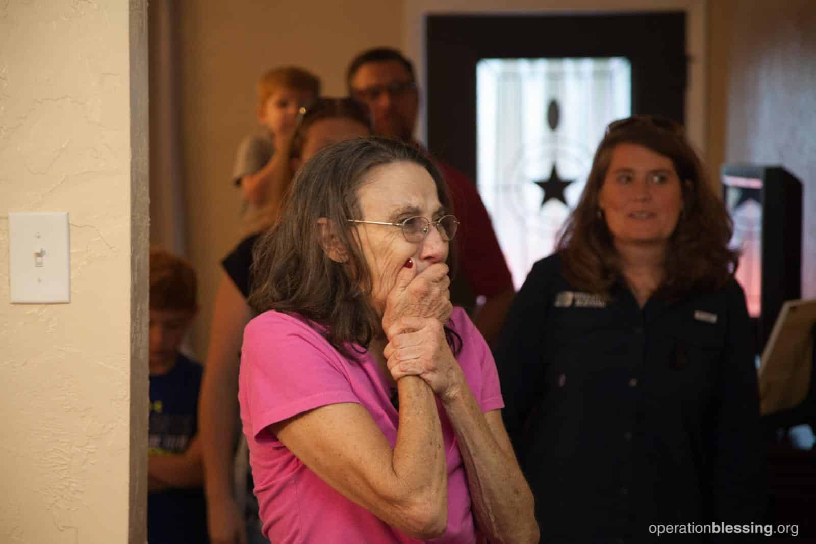 Priscilla is overcome by emotion as she sees her new home. Operation Blessing helped in rebuilding her life.