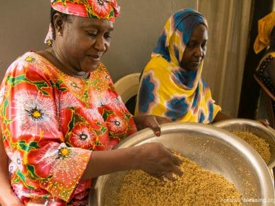 Aminata makes cous cous, which she can now sell at her new business from Operation Blessing.