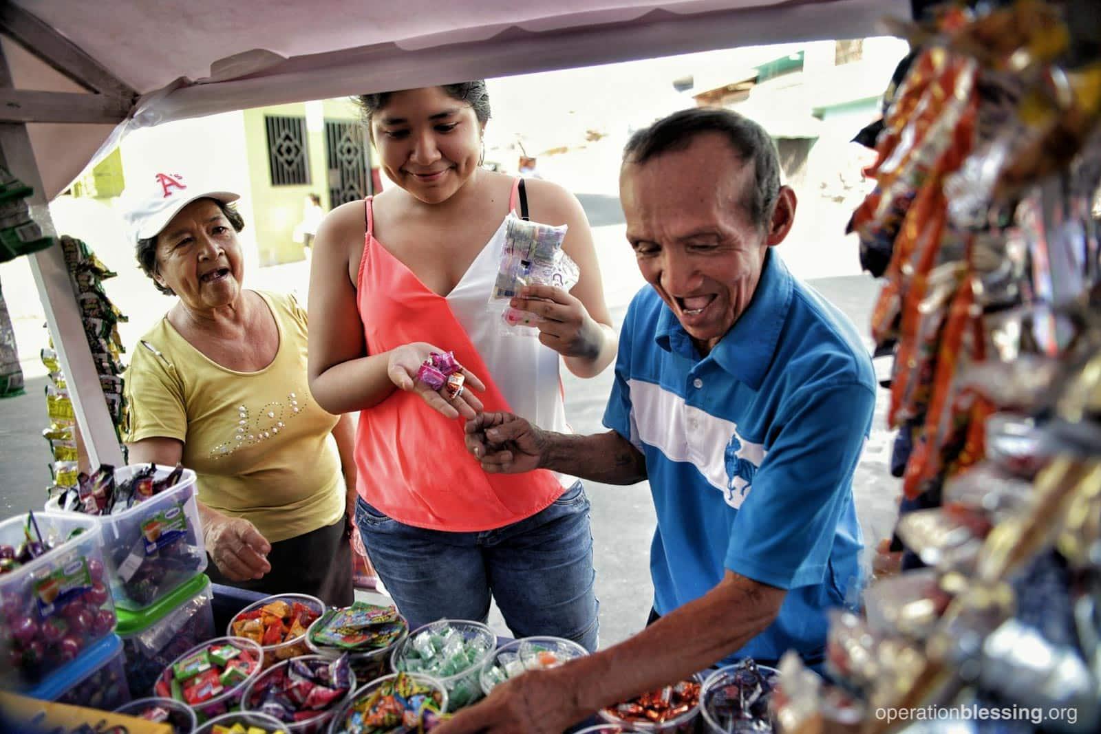 Luis serving customers.