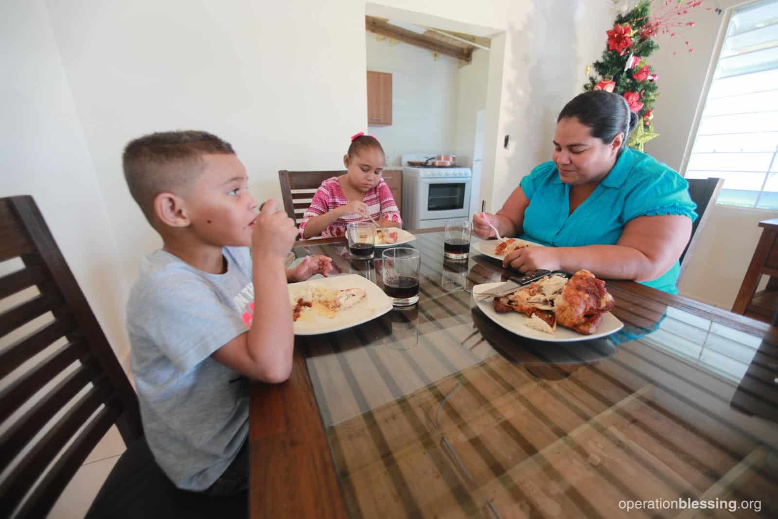 This family in Puerto Rico shares a happy meal together after they weathered many life storms.