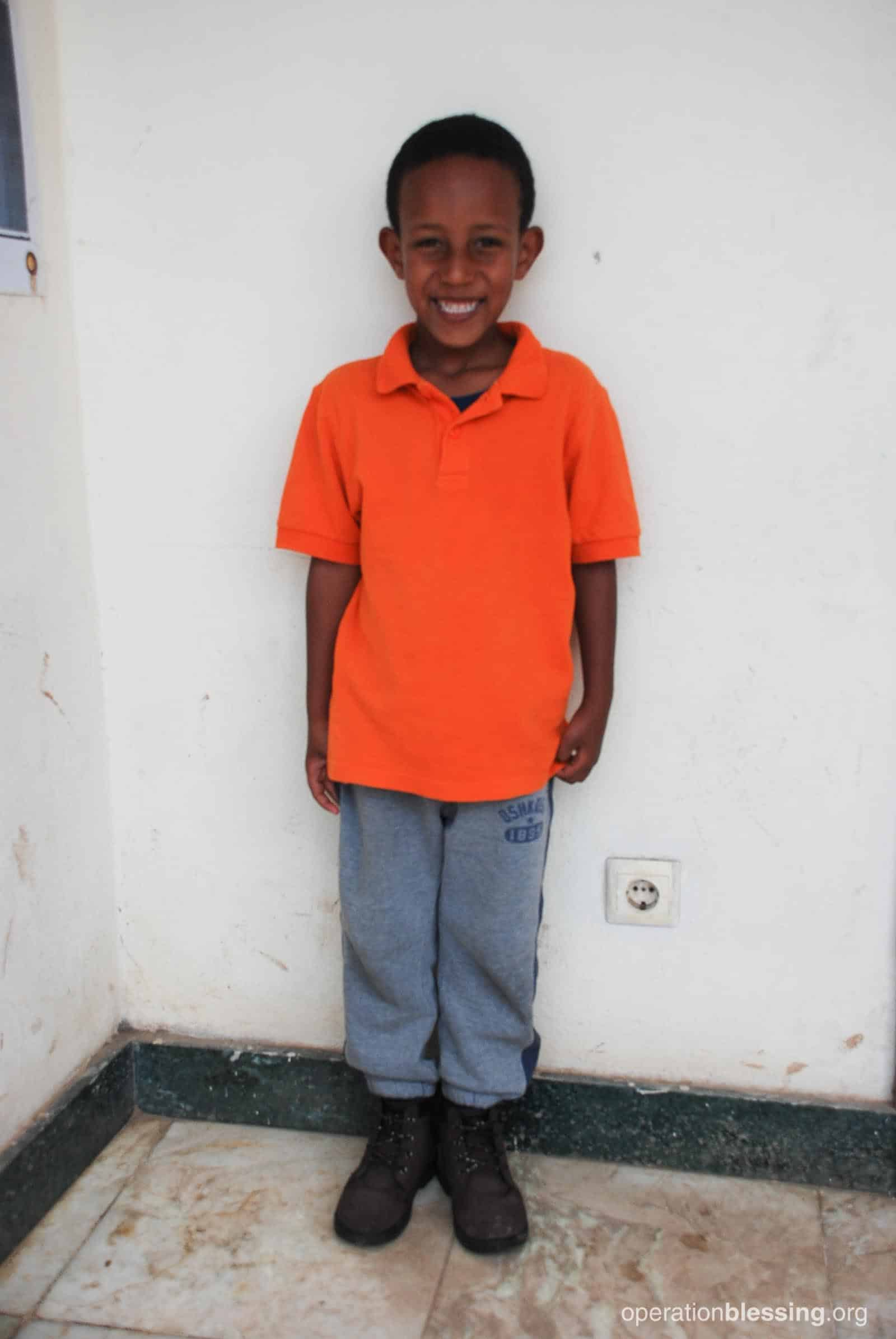 Abenezer is happy and healthy and gets nutritious meals thanks to the Embracing Hope school program.