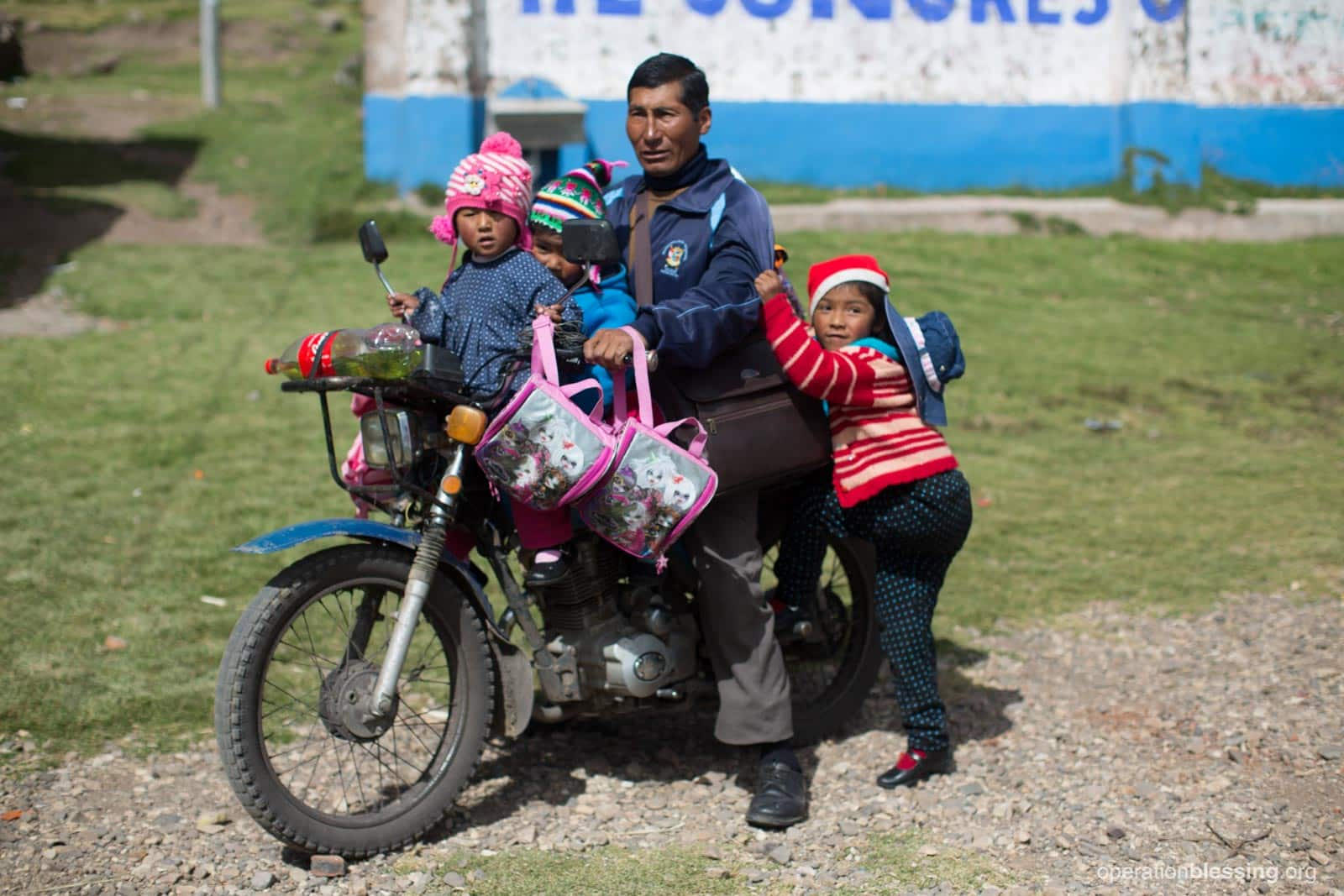 This dedicated preschool teacher in Peru picks up his students on his motorcycle, piling on several at one time.