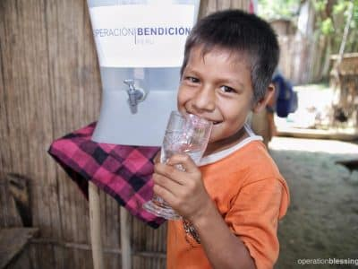 Rosa's son, Jorge, takes a drink of safe water. He is no longer at risk for cholera.