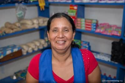 Rosa smiles as she stands in her store, knowing it will help support her daughters' dreams.