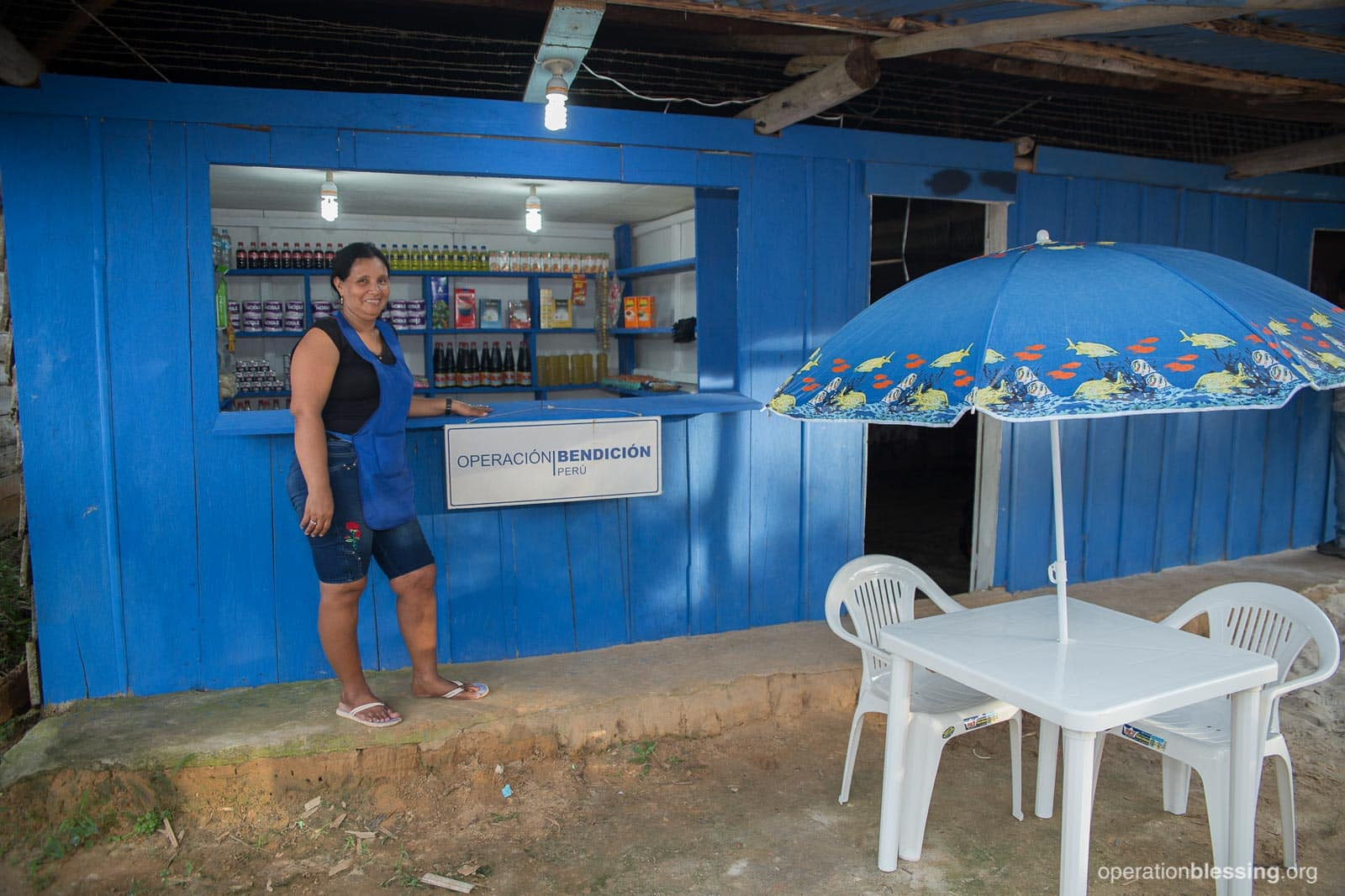 Rosa stands in front of her store, gifted to her by Operation Blessing.