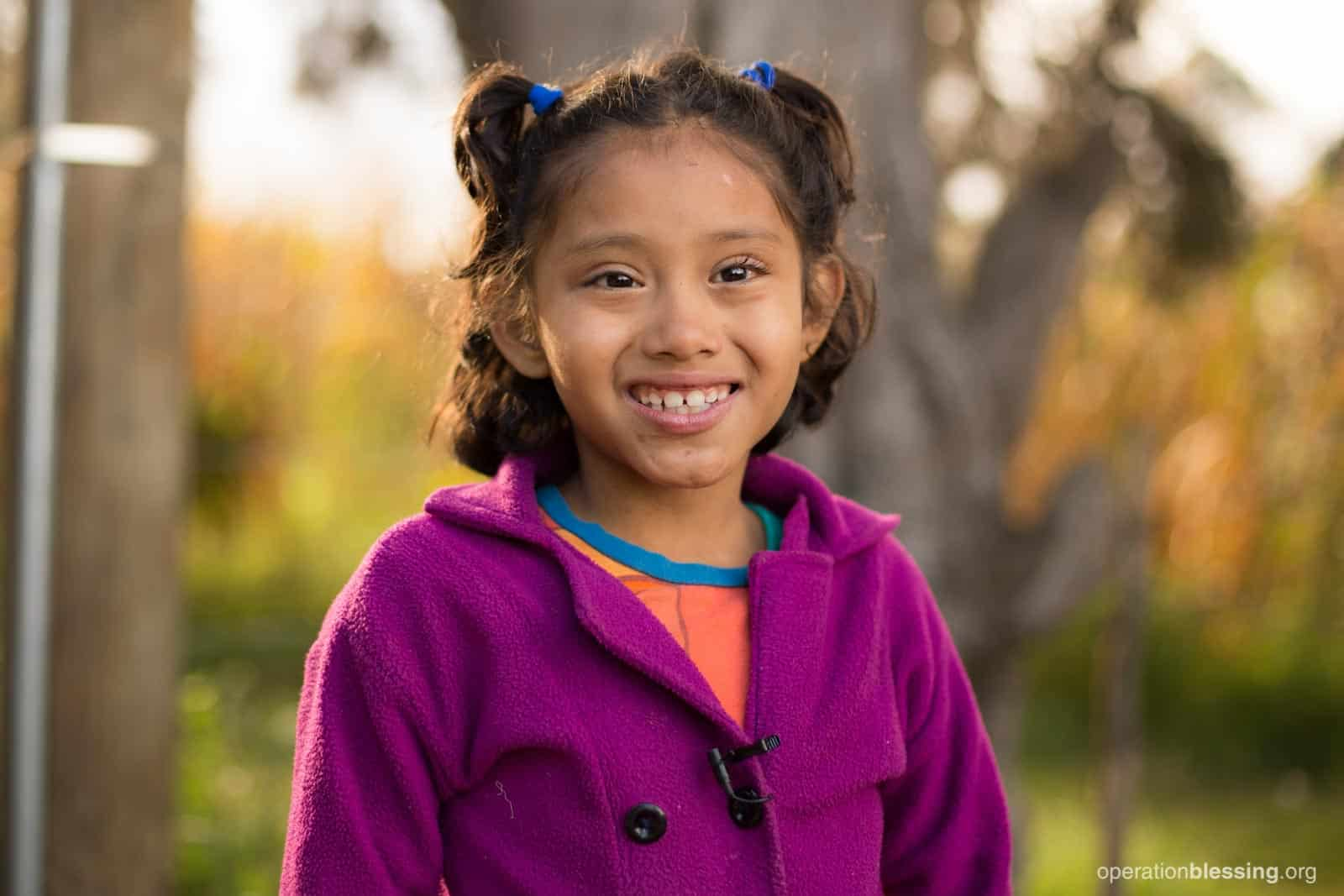 Dulce smiles after her operation provided by Operation Blessing.