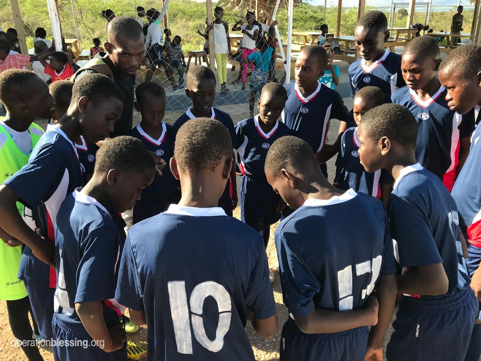The soccer team from OBI's ENLA school in Haiti.