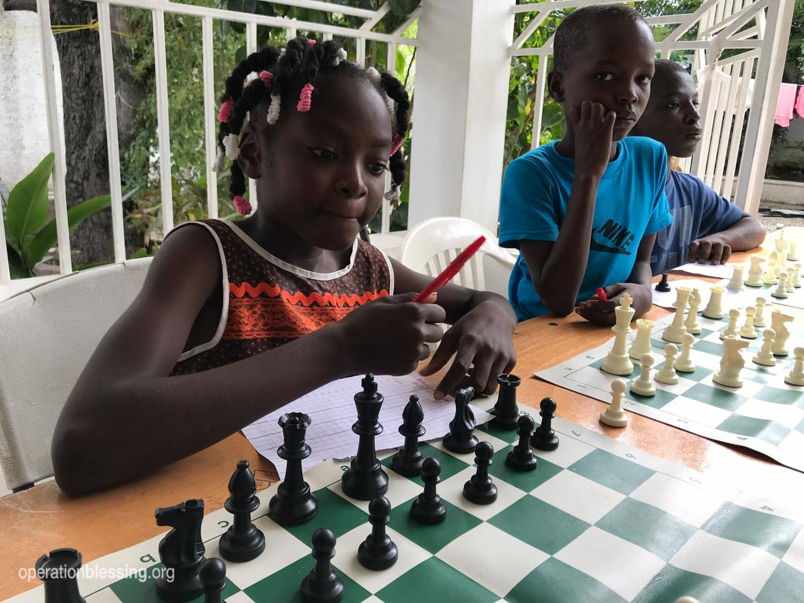 These children are learning important life skills through a chess camp in Haiti.