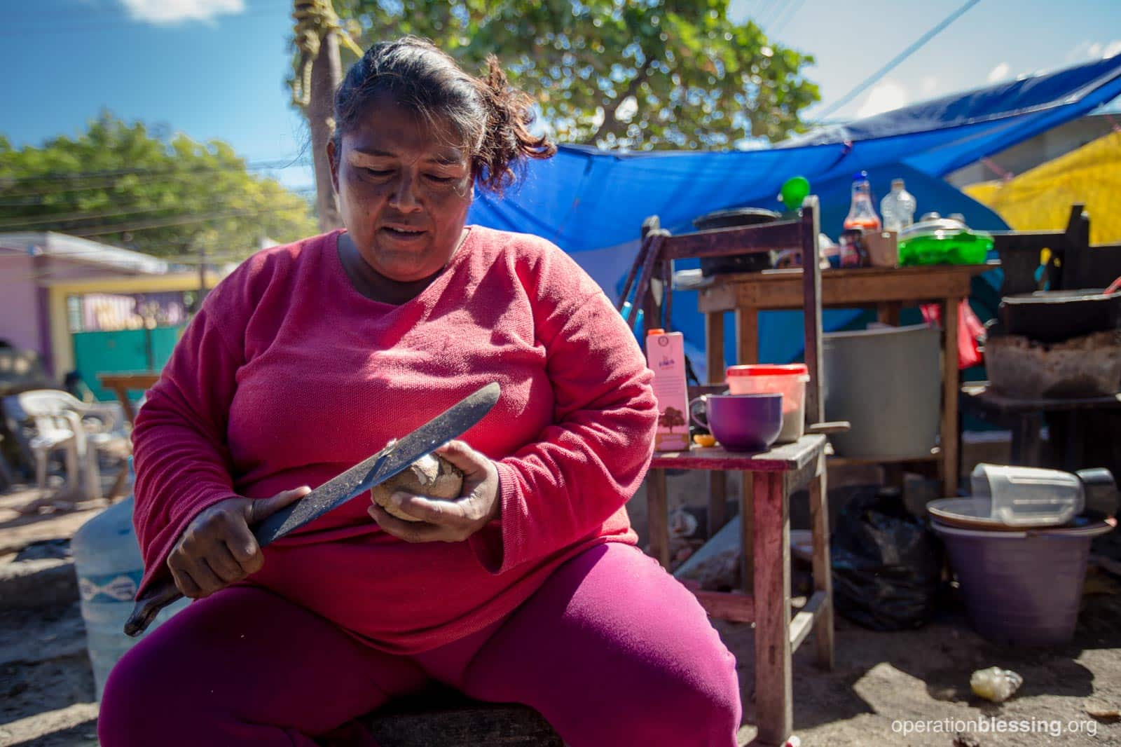 Bernarda working in their old makeshift kitchen before the sisters received assistance from Operation Blessing.