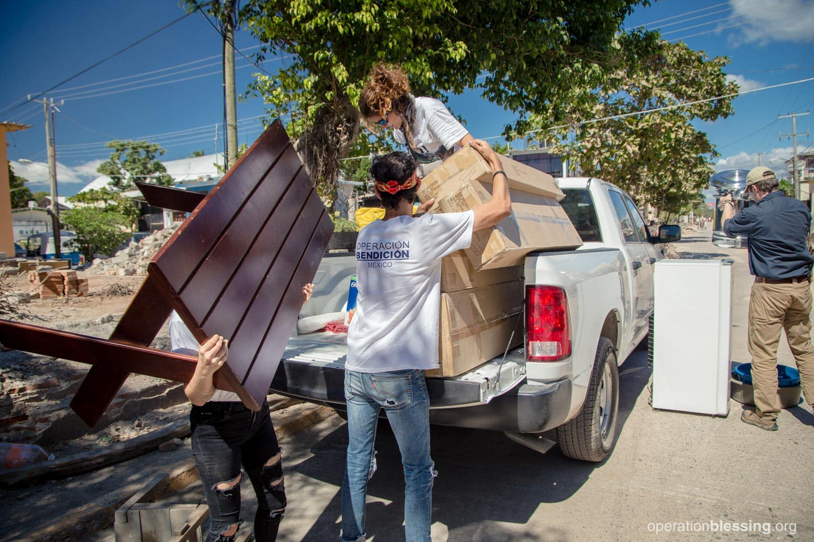 Supplies for the new kitchen being unloaded from the truck by OBI workers.