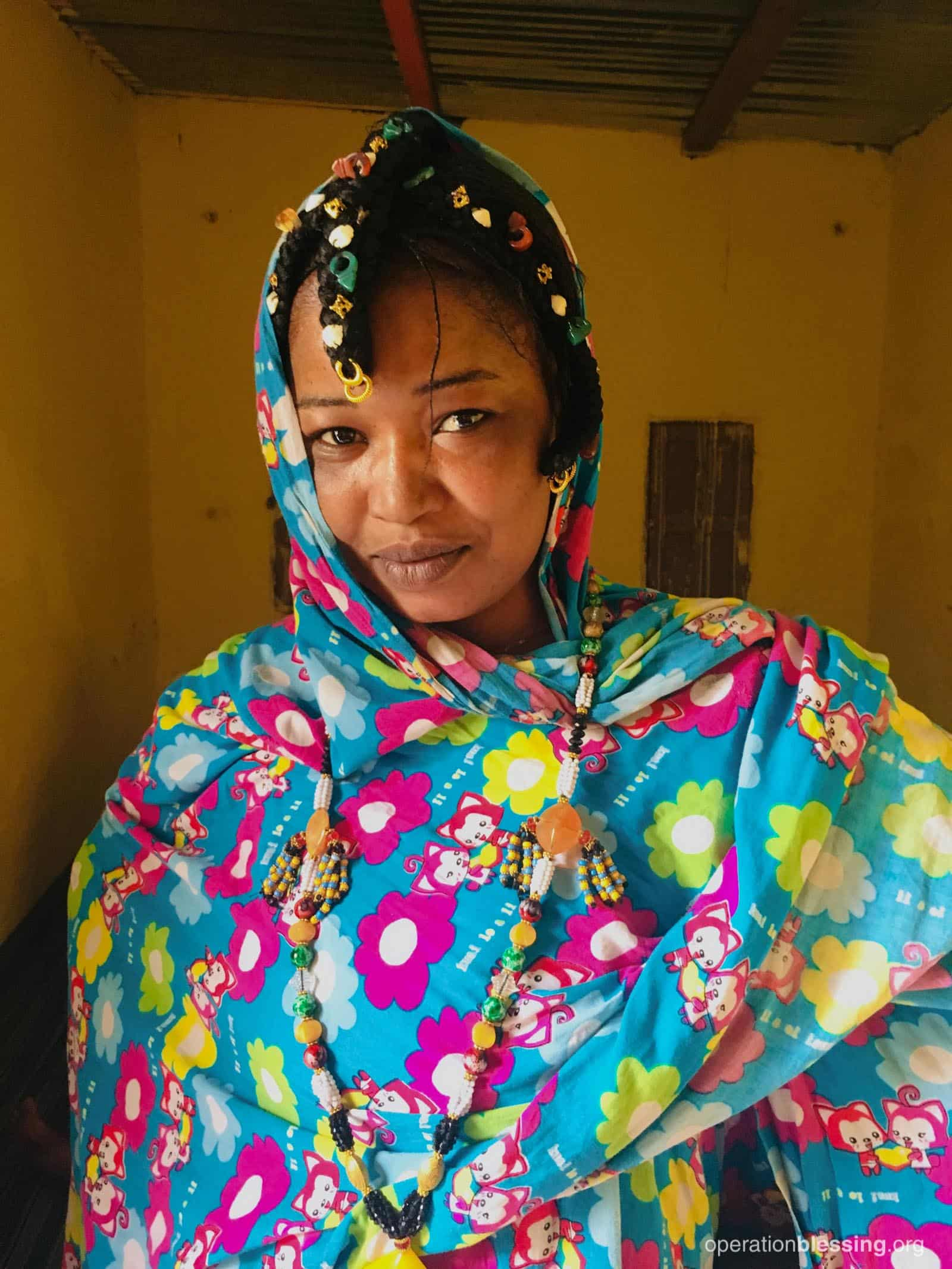 This is just one of the women learning sewing at the OB Lifeskills Training Center.