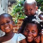 Salima with her children after receiving assistance from Operation Blessing Supporters and Abide Family Center in Uganda.