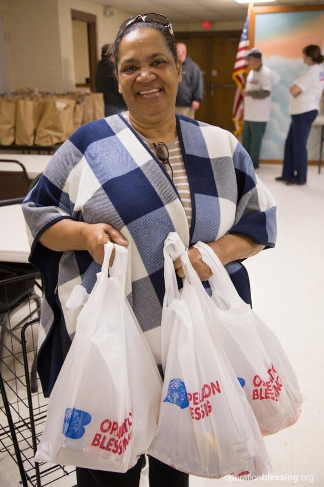 Marie with bags full of groceries from Friends First in Portsmouth, Virginia.
