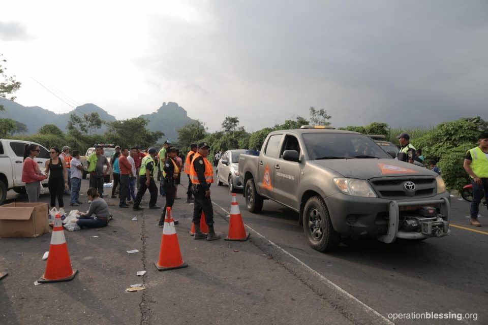 Disaster workers near Fuego volcano.