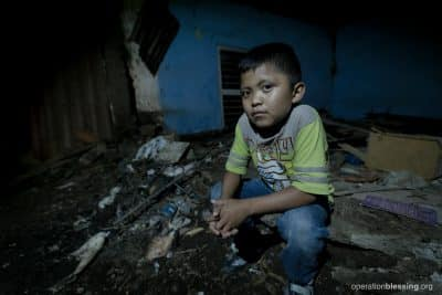 Uziel sits on the rubble from when the ground quaked in Mexico.