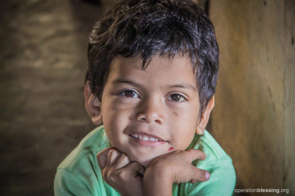 Marta's youngest child, William, smiles.