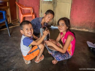 Marta's kids play happily since they no longer go hungry thanks to help from Operation Blessing partners.