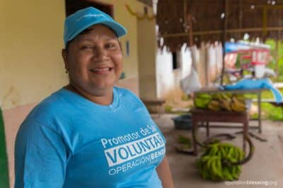 Juanita smiles at the amazing opportunity she's been given to serve those around her as a volunteer community health worker.