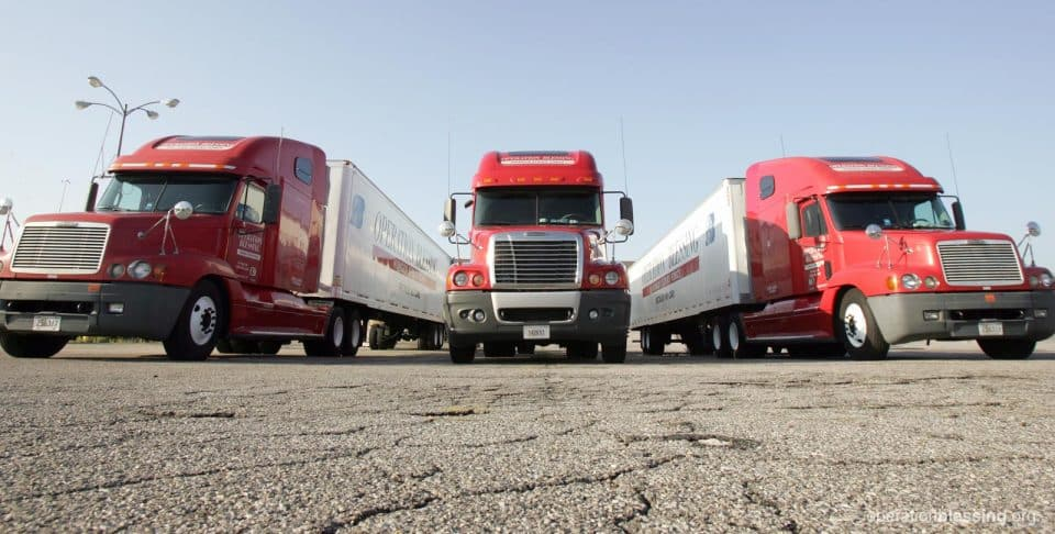 Semi-trucks from OBI's Hunger Strike Force deliver food and supplies in the U.S.