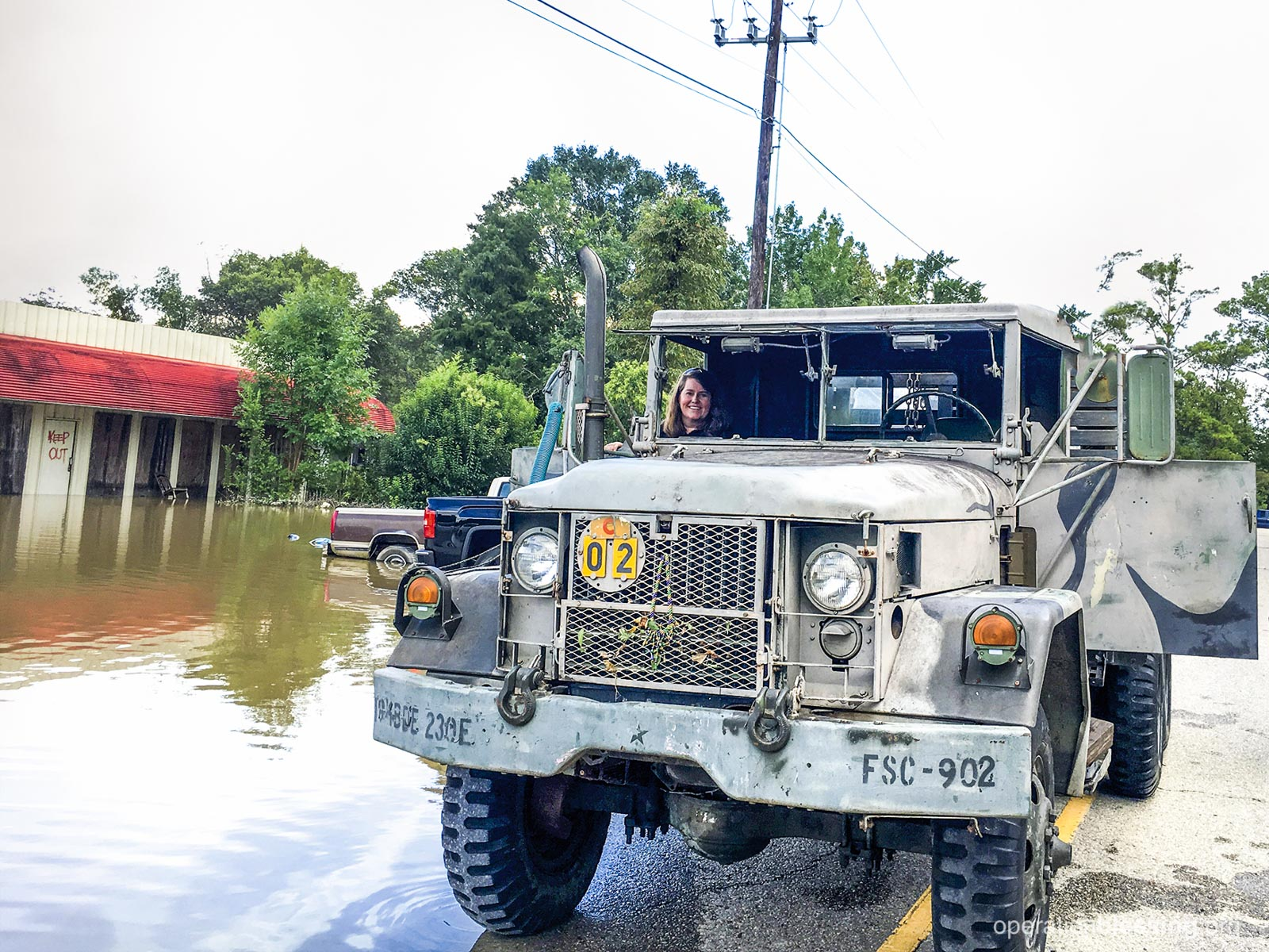 Using an army truck to reach flood victims.